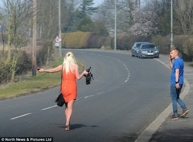 The girl, stiletto shoes and bottle of drink in hand, and her male companion made their way home after the night's fesitivities