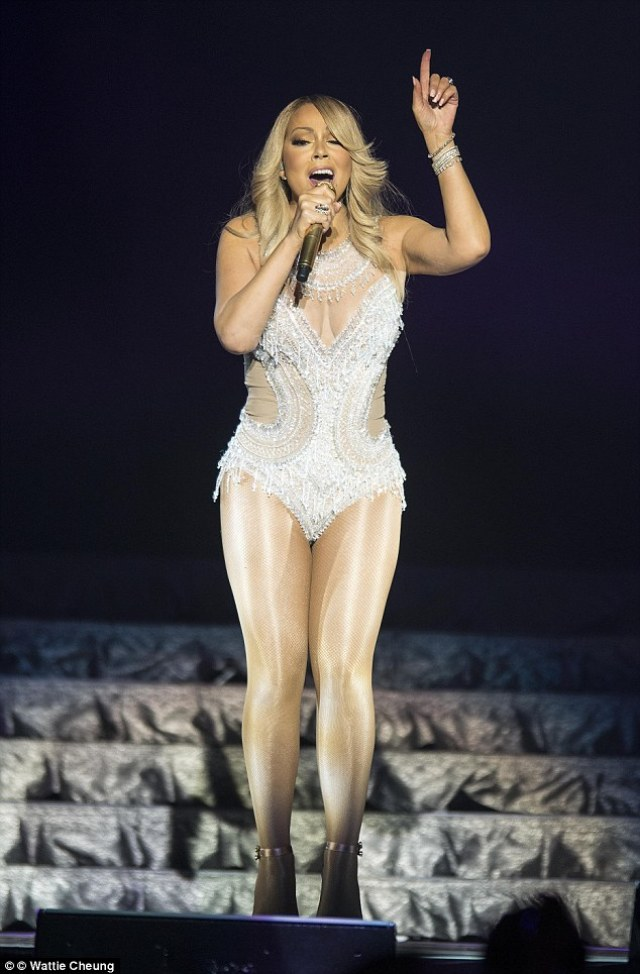 Looking fabulous: The pop diva looked sensational in sexy silver leotard which showcased her ample cleavage and shapely legs