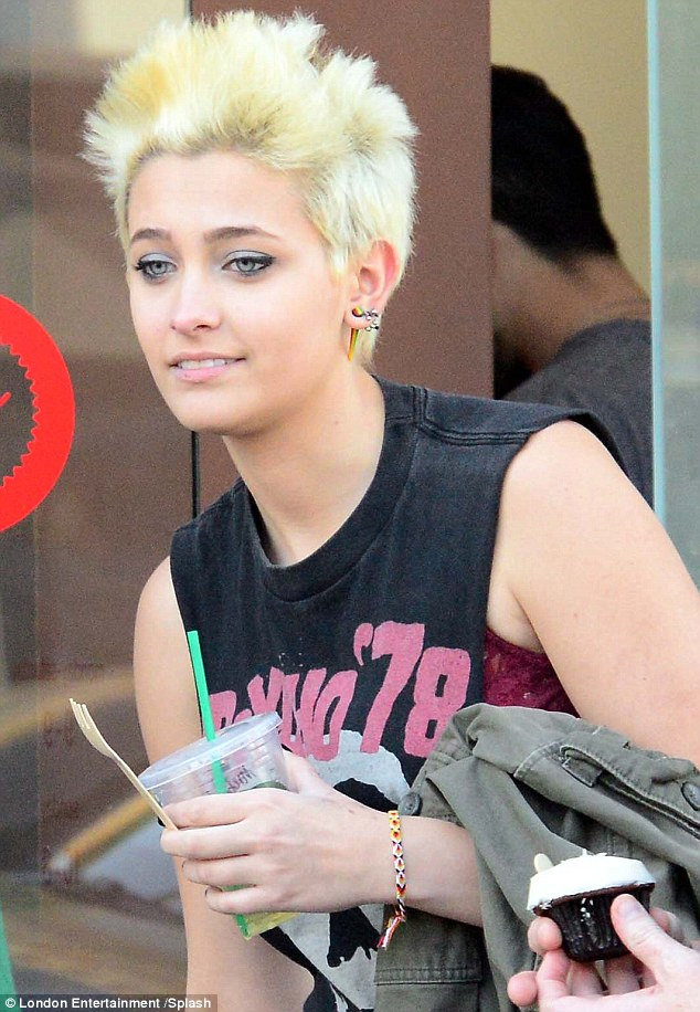 Top of the crops: Paris Jackson continued to style out her newly-dyed platinum blonde spiked 'do as she was pictured out and about in Beverly Hills, Los Angeles, on Tuesday