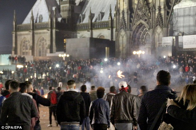 German rape law is set to be extended to also cover cases where the victim was taken by surprise, intimidated or threatened with violence (pictured is the crowds in Cologne during the New Year's Eve mob attacks)