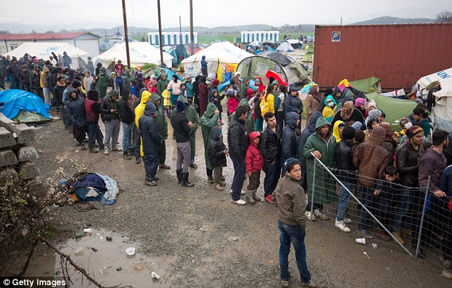 Cameron will travel to Brussels for a summit on stemming the flow of Syrian refugees on the EU's eastern borders (pictured, migrants at squalid Idomeni camp)