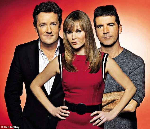 'Simon always tells me he is responsible for making people like me. Of course I hate him saying that, but it's true,' said Amanda (pictured with her then co-judges Piers Morgan and Cowell on Britain's Got Talent)