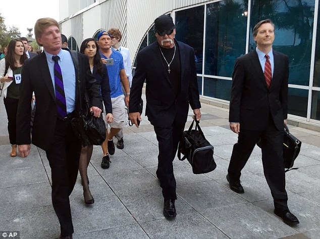 Hogan out: Hulk Hogan exits the courtroom with his legal team on Friday after the verdict was announced by the jury