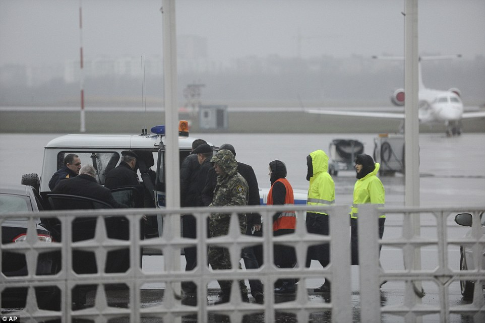 Russian Emergency Situations Ministry employees and police officers are pictured on their way to the plane crash
