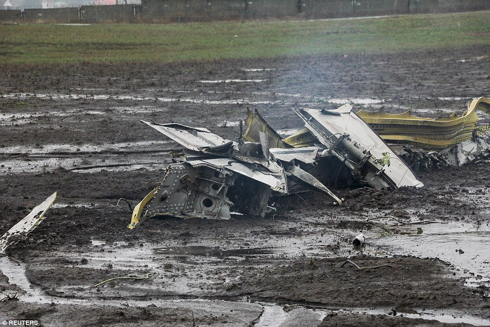 The plane appears to have disintegrated after hitting the ground, with a piece of the fuselage scattered across the crash site