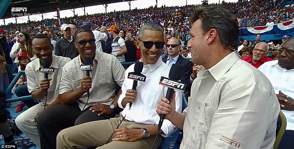 Jovial: President Obama was clearly enjoying the historic baseball game which was played between the Tampa Bay Rays and the Cuban national team