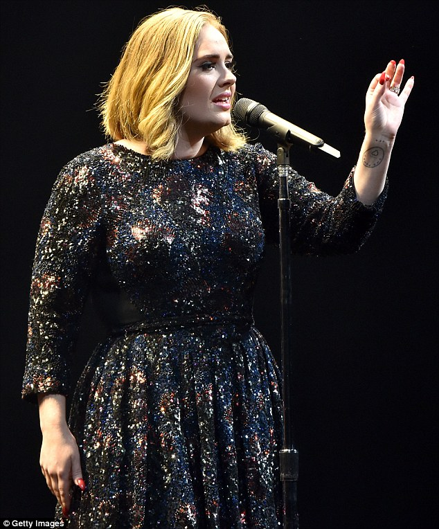 Defiant: Adele labelled the terrorists behind the Brussels bombings 'f**ers' during her concert at the O2 Arena on Tuesday night, as her fans lit up the venue with their phones as a show of support to the city