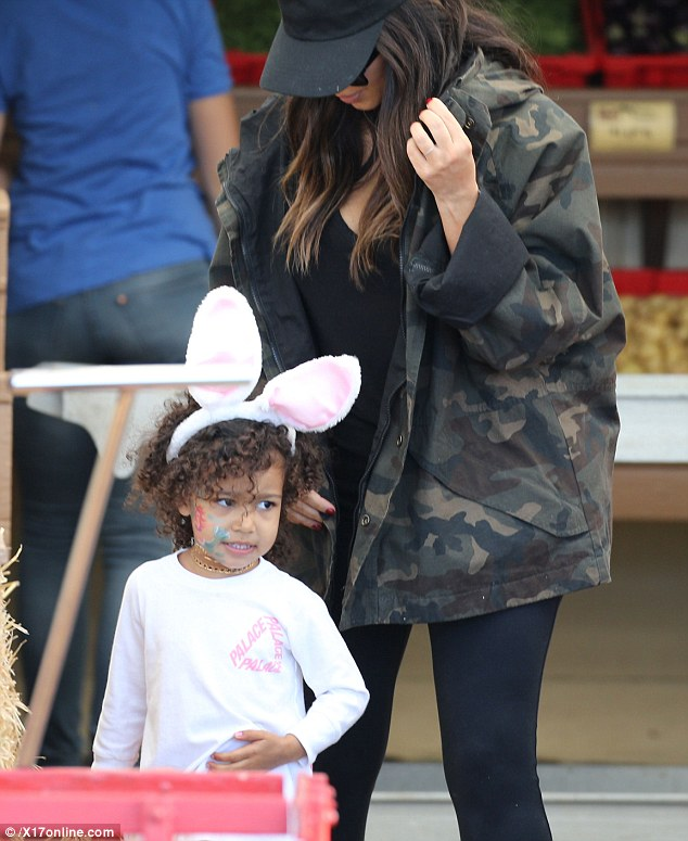 Almost didn't see her: The mom-of-two opted instead for a black leggings and top combo, covering up in a heavy camouflage jacket