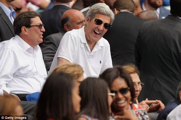 Secretary of State John Kerry was also in Cuba during the attack, stayed, and was pictured at the game Tuesday - above. Wednesday afternoon the US announced he will fly to Brussels Friday to offer condolences