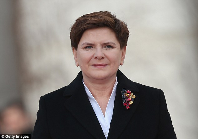 PolishPrime Minister Beata Szydlo (pictured) today said she was 'not OK' with allowing migrants to settle in her country following the attacks in Brussels