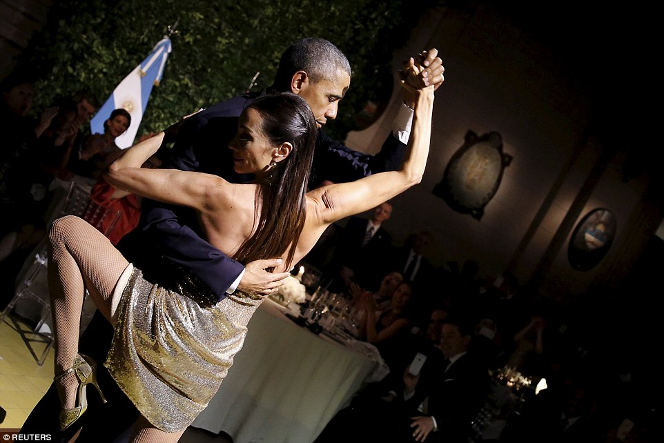 President Barack Obama was pictured dancing the tango this evening at a state dinner in Buenos Aires as he pushed ahead with his two-day state visit to the country despite intensifying calls for him to return home following the Brussels terror attack