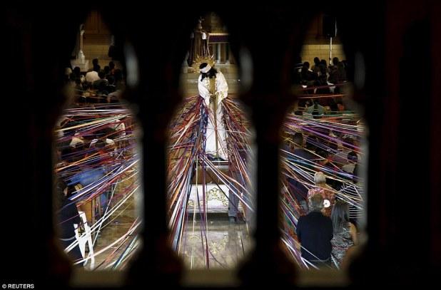 In Costa Rica, Catholics tied coloured tape to a statue of Jesus inside the San Antonio de Padua Church