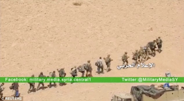 Advance: Syrian government soldiers mark into what local media claims in Palmyra on Thursday, as the army moves to recapture the historic city from ISIS