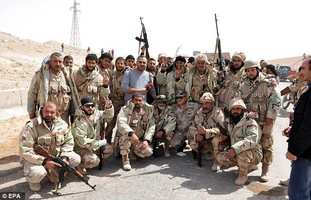 Members of the Syrian Amry celebrated their victory over ISIS in the city of Palmyra earlier today