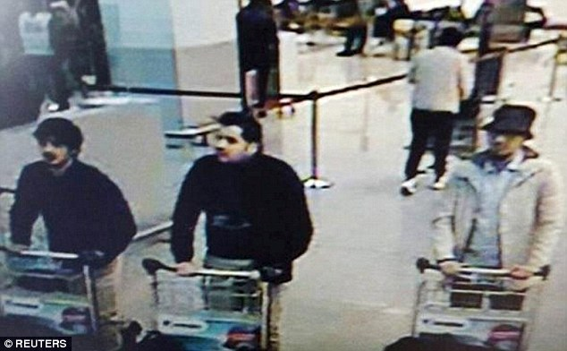 Belgium media reports suggest Cheffou, a freelance journalist, is the third bomber pictured far right, walking through Brussels Airport before the attacks wearing a white coat and hat
