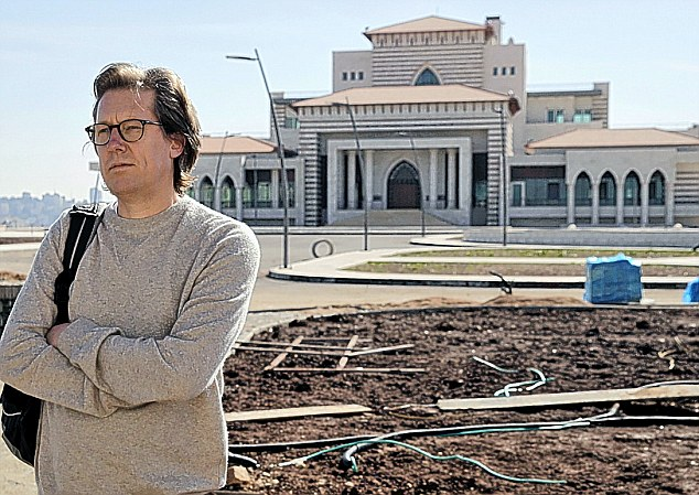 Grand: Ian Birrell at the £8million presidential palace on the westbank - built by a country that got £72million in foreign aid