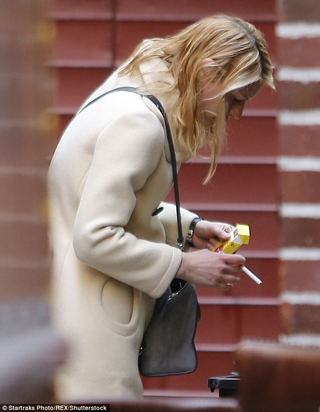 Up in smoke! The Golden Globe winner reached into her handbag and pulled out an American Spirit cigarette