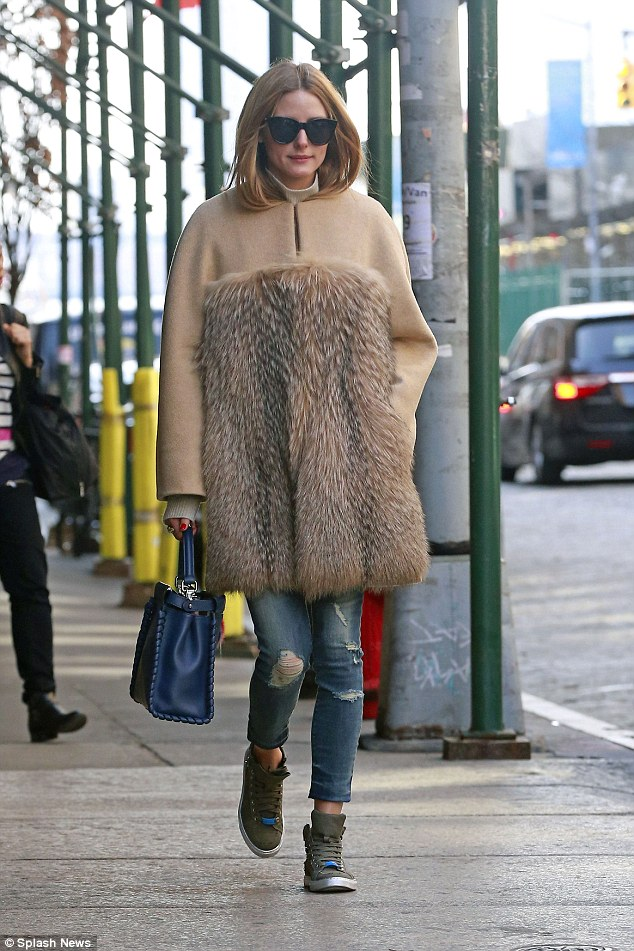 Style queen: The unusual garment resembled a typical beige fleece across the shoulders and arms, before transitioning to fur around the bust in a bandeau style