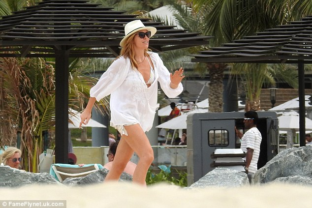 Run along!Later in the day, as the family enjoyed a frolic in the surf, yummy mummy Abbey opted to cover-up her toned figure with a loose-fitting, linen kaftan