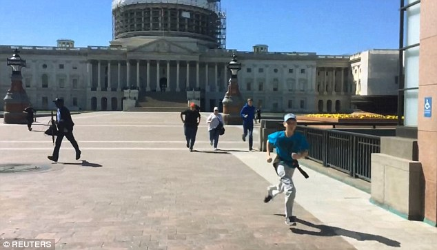 Visitors run from the US Capitol building after shots were fired at around 3pm on Easter Monday