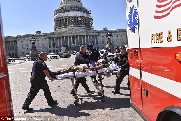 Lone gunman Dawson was stretchered to an ambulance after being shot by police, and transported to hospital