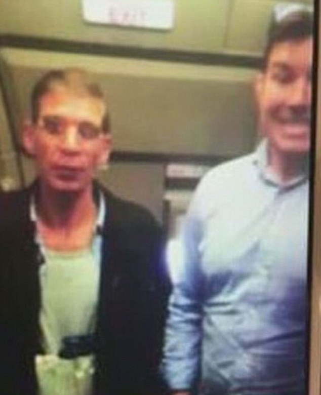 The hijacker, identified as Seif El Din Mustafa, is seen wearing his 'suicide belt', as an unknown man standing next to him on the plane pulls a silly face while taking a selfie