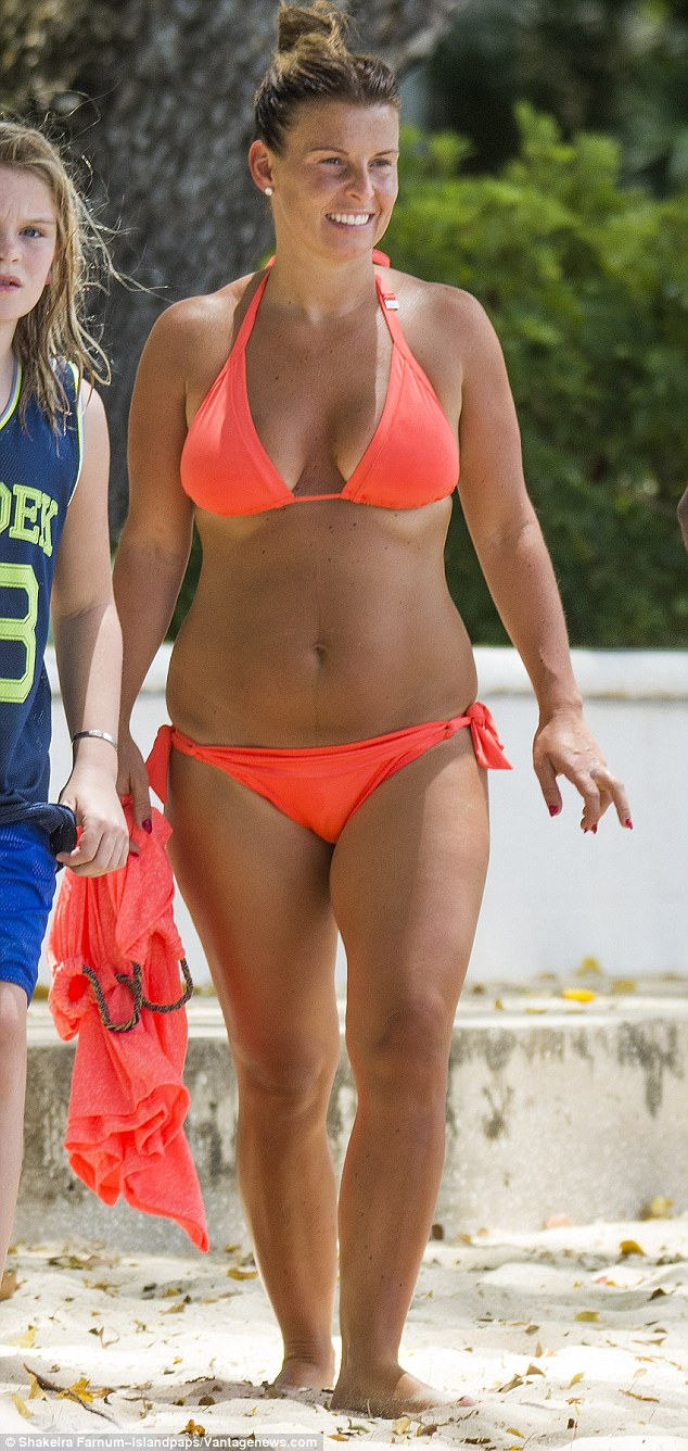 Skimpy look:Coleen has been reveling in a sun-soaked vacation with her three sons, which also include Klay, two and newborn addition, two-month-old Kit as well as her parents Colette and Tony, yet Manchester United ace Wayne has remained at home