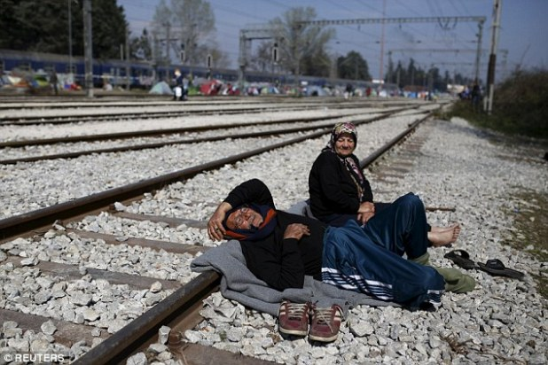 Migrants blocked a railway at the Greek-Macedonian border near the village of Idomeni on Tuesday