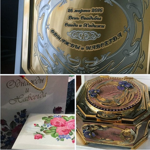 Now that's a party bag: Guests were presented with a delicate gold box engraved with the couple's names and date of the wedding
