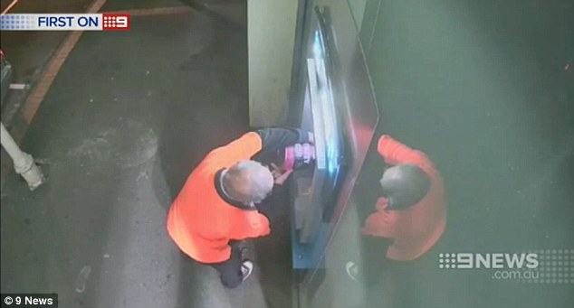 The man then allegedly pours petrol onto the ATM