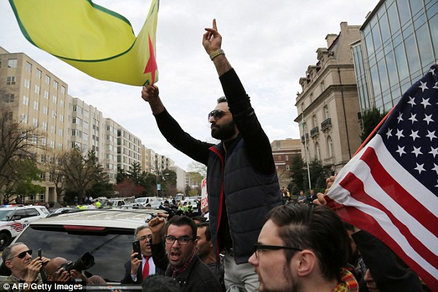 Dozens of anti-Erdogan protesters, largely from the Kurdish ethnic group who have been helping fight ISIS in northern Syria, gathered outside Brookings on Thursday (pictured)