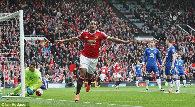 Anthony Martial wheels away in celebration after scoring the winner for Manchester United
