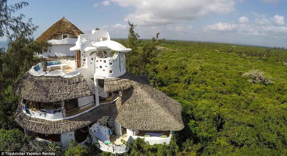 The white, unusually-designed property looks like something from a fairytale, with its thatched roofs, mosaic glass inside and its panoramic views of the Indian Ocean