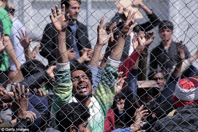 MYTILENE, GREECE -  APRIL 05:  Refugees from Afghanistan and Pakistan protest at the detention center against their deportation to Turkey on April 5, 2016 in Lesbos, Greece. Scores migrants are being returned to Turkey following an EU agreement with the Turkish authorities to tackle Europe's worsening mass migration crisis. Migrants who have arrived illegally in Greece are now being deported back to Turkey if they refuse to apply for asylum. (Photo by Milos Bicanski/Getty Images)