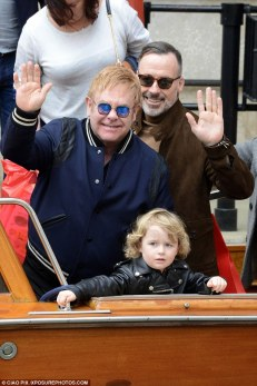 And as he is now: Sir Elton John enjoying spending time with his husband David Furnish and two children, Zachary and Elijah. The Italian city is one of many where the couple have homes