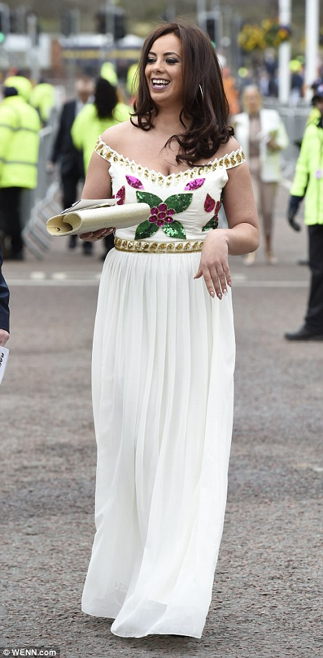 Another racegoer opted for the Grecian goddess look in a white embellished max dress that showed off her shoulders