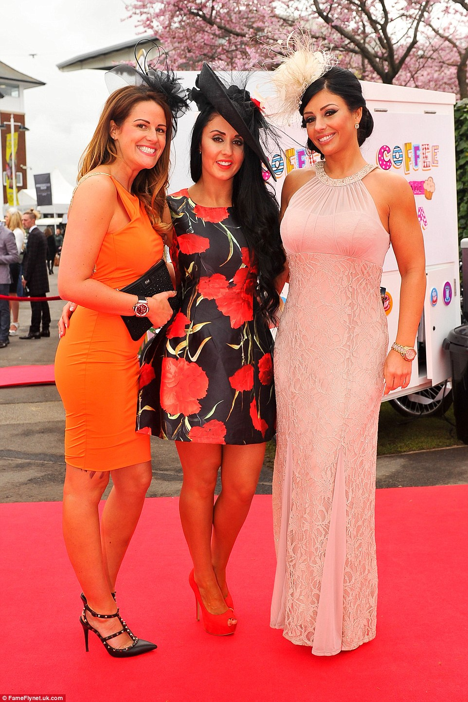 A colourful trio prepare to enjoy their day at the races