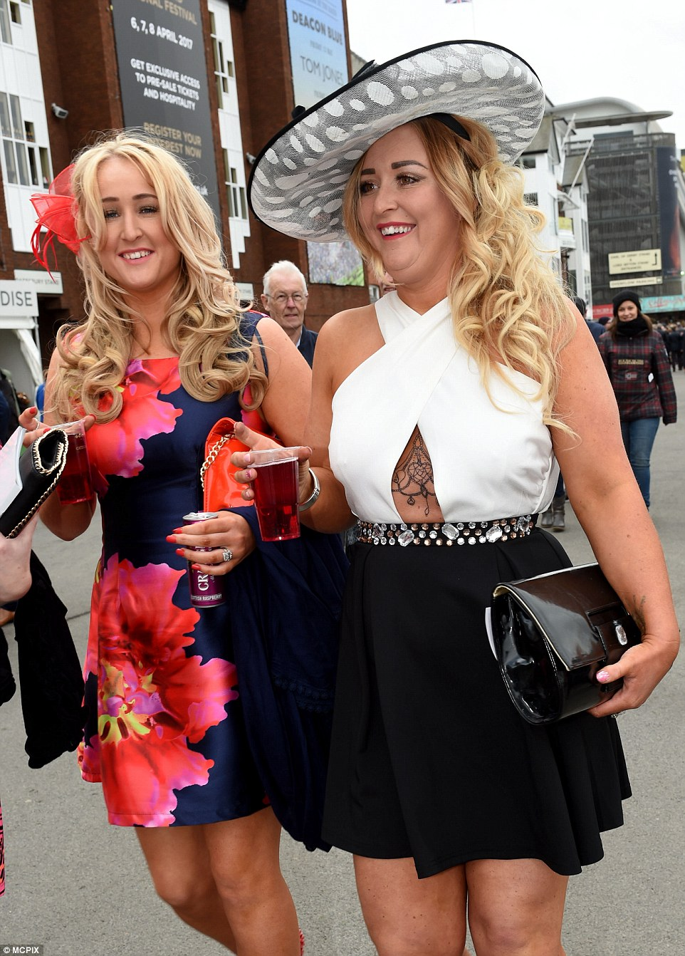 A woman showed off a hint of her tattoo in a monochrome dress with a cut out at the waist