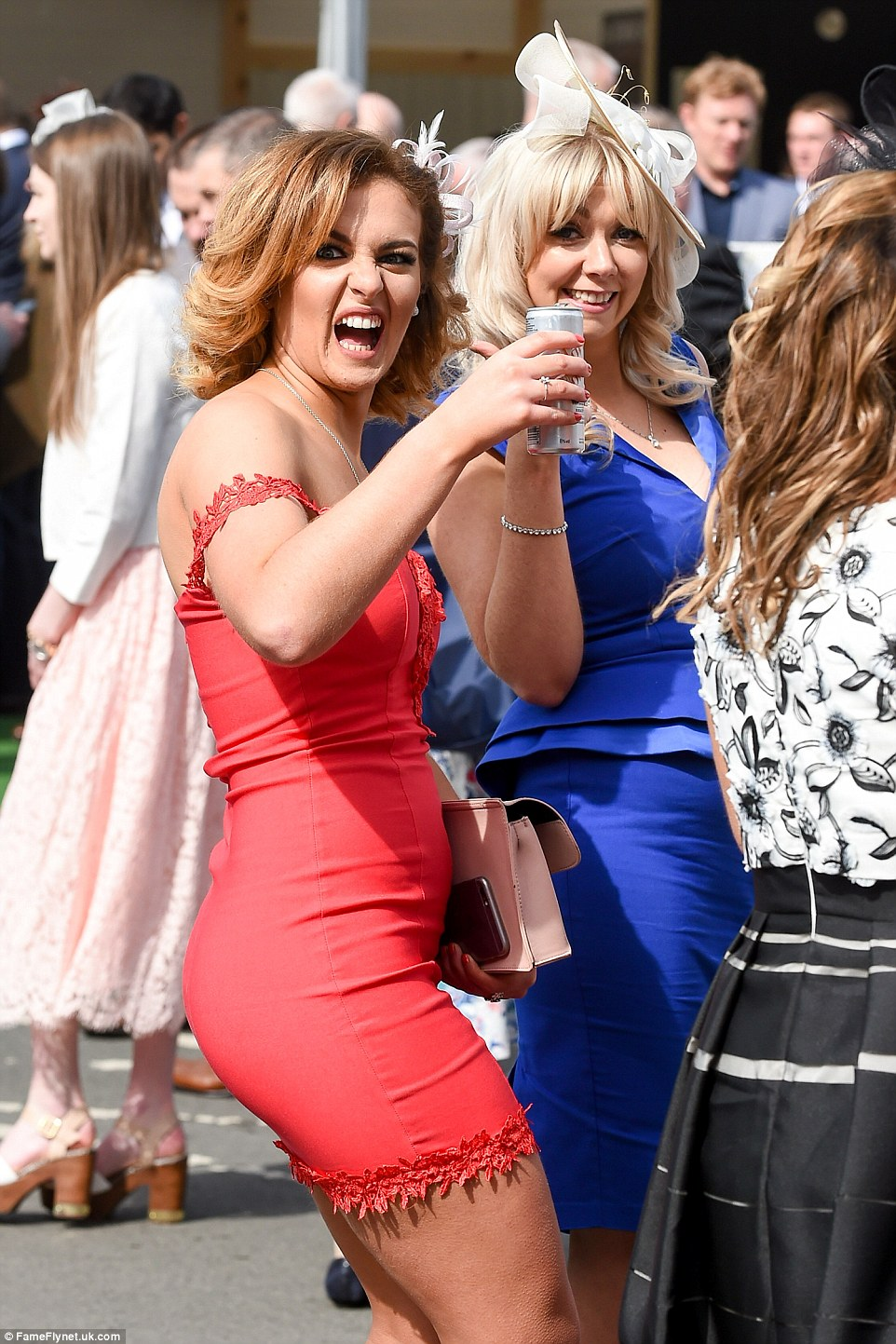 Raising a toast: There was a lively atmosphere at the course as revellers celebrated a rare break in the clouds