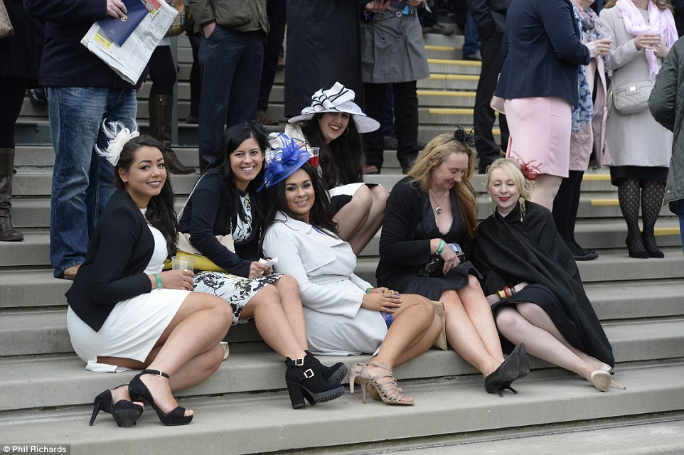 A group of ladies took the weight off their feet, pausing for a sit down on a flight of steps