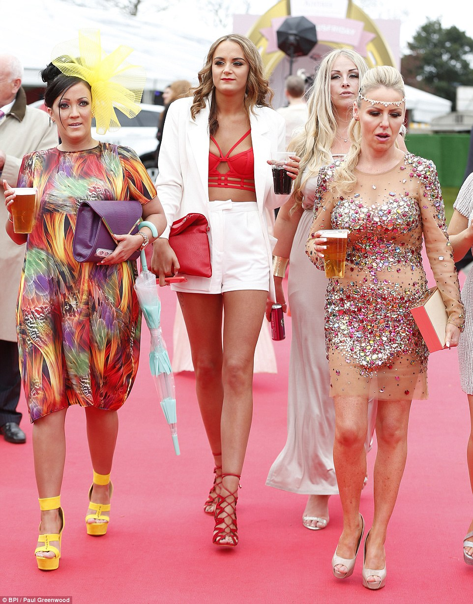 A glamorous group went all out with one woman, right, choosing an all-over embellished dress with a diamante head band