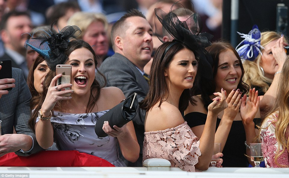 A woman looked like she'd backed a winner during the Alder Hey Children's Charity Handicap Hurdle (left) but her companions seemed like they had been left disappointed