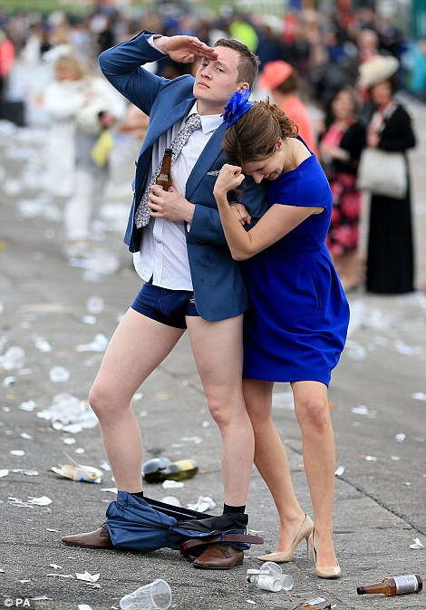 A man was also seen dropping his trousers at the end of the day as his female companion struck a pose alongside him