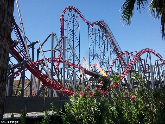 X2 reaches speeds of 76mph and features two 'raven turns' - half loops that turn into sheer drops. Pictured is the terrifying initial drop