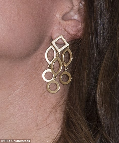 She also wore £1,495 earrings by Temple of Heaven