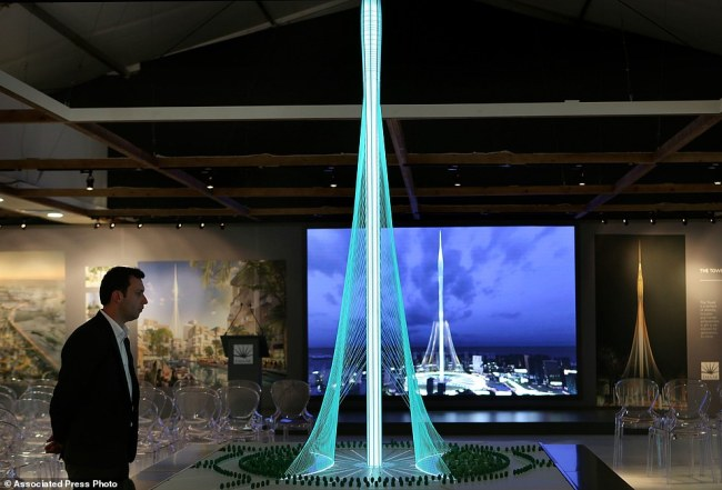 A man walks past a model of the Tower Project at Dubai Creek Harbour Development designed by Spanish-Swiss architect Santiago Calatrava Valls