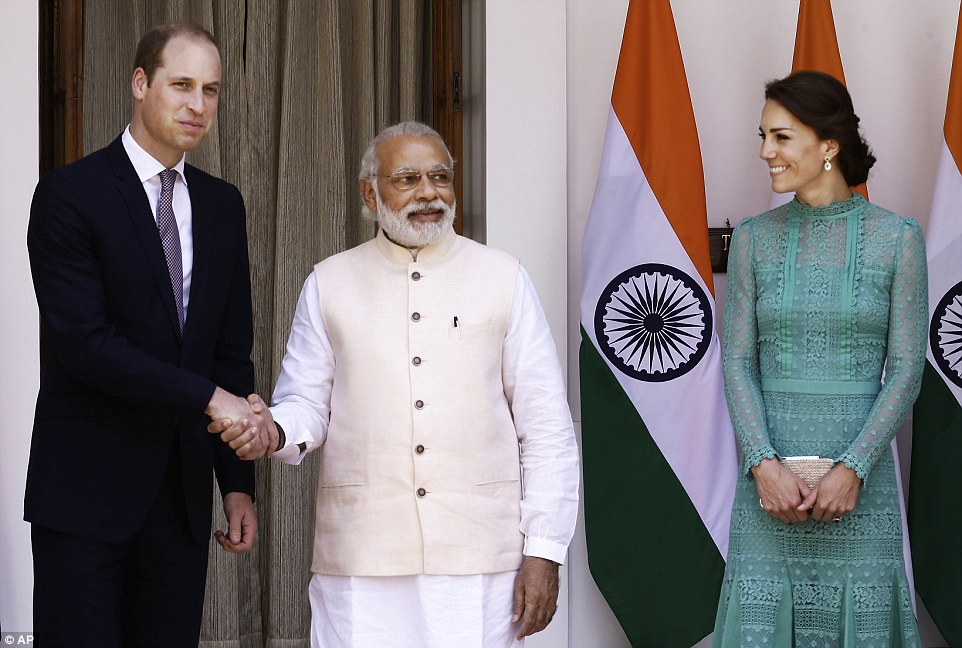 Formal: Prince William (left) shakes hands with Indian Prime Minister Narendra Modi as he and wife Kate arrive for lunch in New Delhi