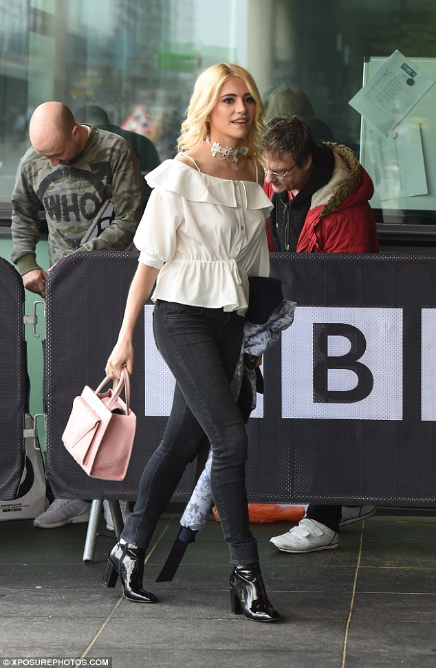 Pixie Lott Flashes Her Shoulders Arriving At BBCs