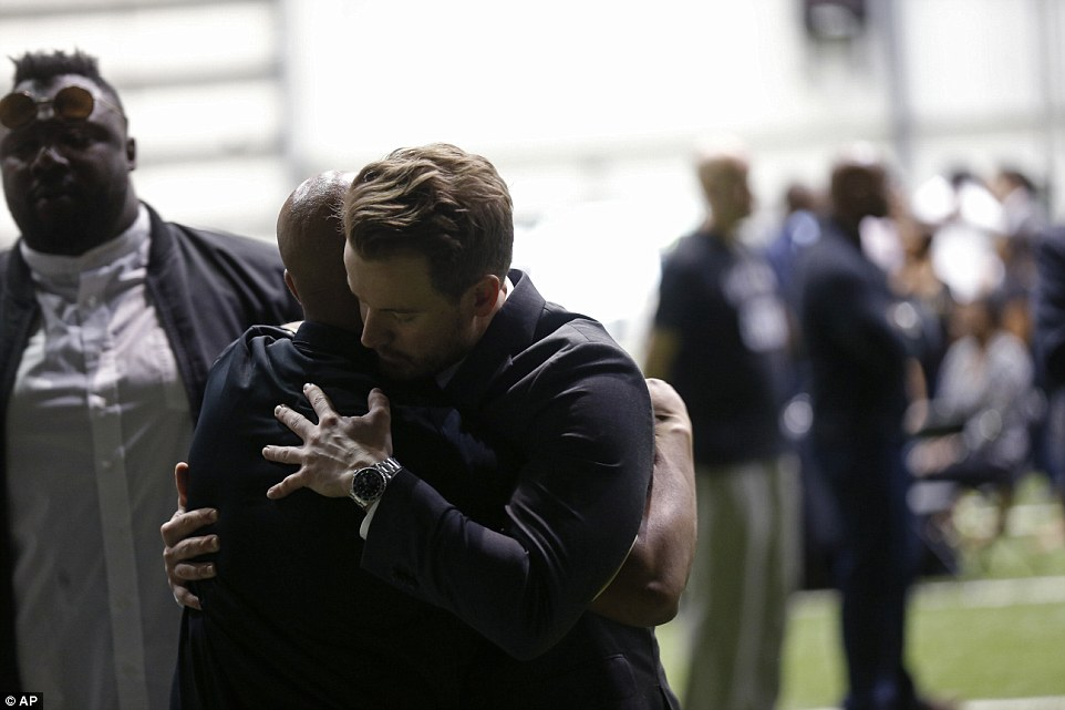 Emotions were on display in the Saints training center where Smith's casket was laid out on Friday. People hugged and talked, some dropped to their knees in prayer, while others simply stood in silence and reflected