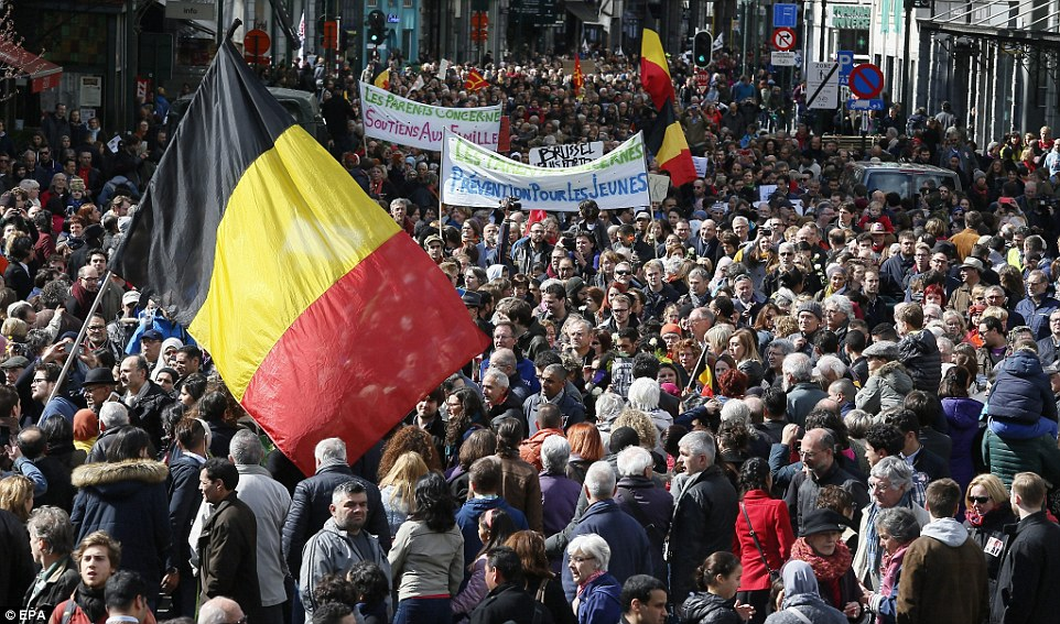 More than 7,000 people marched through Brussels in a peaceful protest 'against terror and hatred'